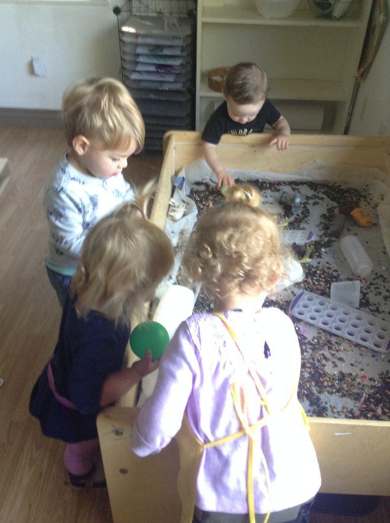 Toddlers at sensory bin